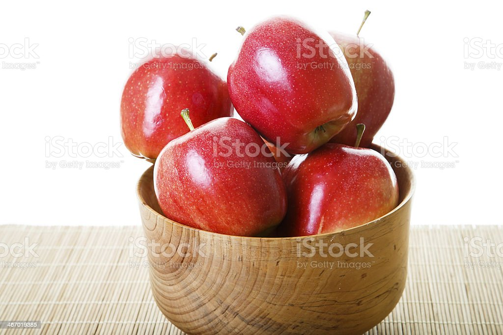 Red Apples in Wood Bowl on White Background royalty-free stock photo
