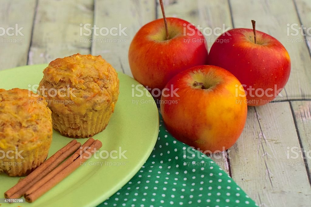 Red apples with apple cinnamon muffins stock photo