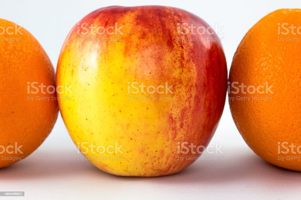 red apples with half orange. stock photo