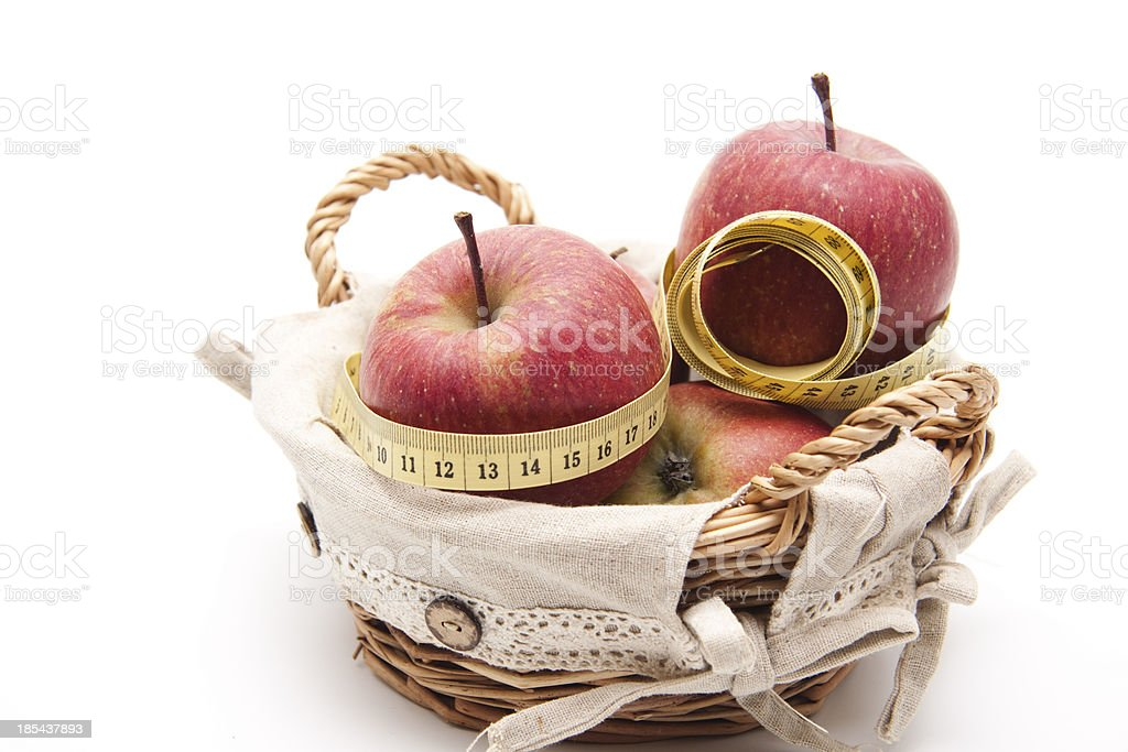Red apples with measuring tape royalty-free stock photo