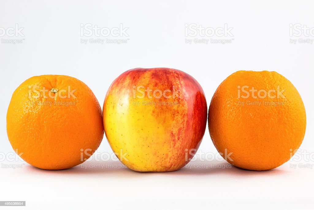 red apples with two orange. stock photo