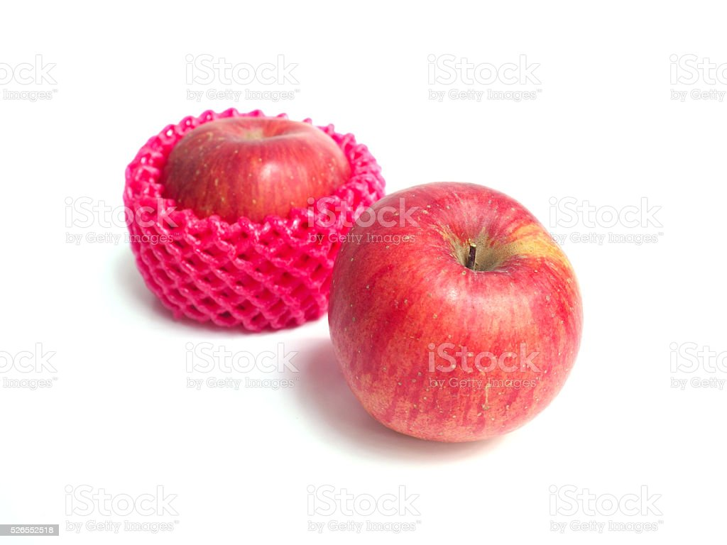 Red apples wrapped by foam stock photo