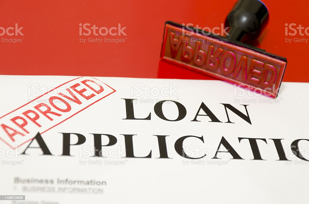 A red APPROVED stamp stamped on a loan application royalty-free stock photo