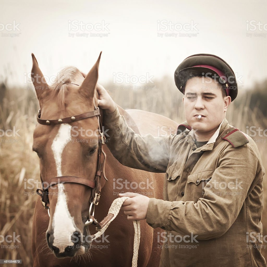 Red Army sergeant and a horse royalty-free stock photo