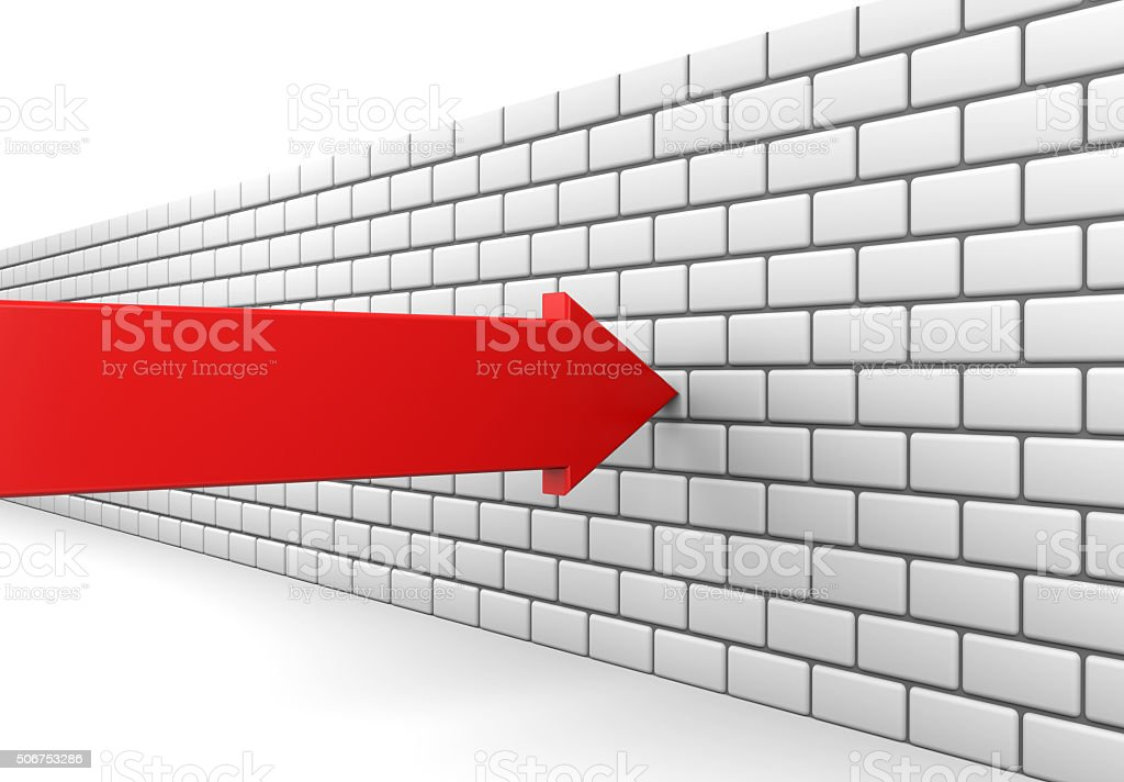 Red arrow crashes into a brick wall stock photo