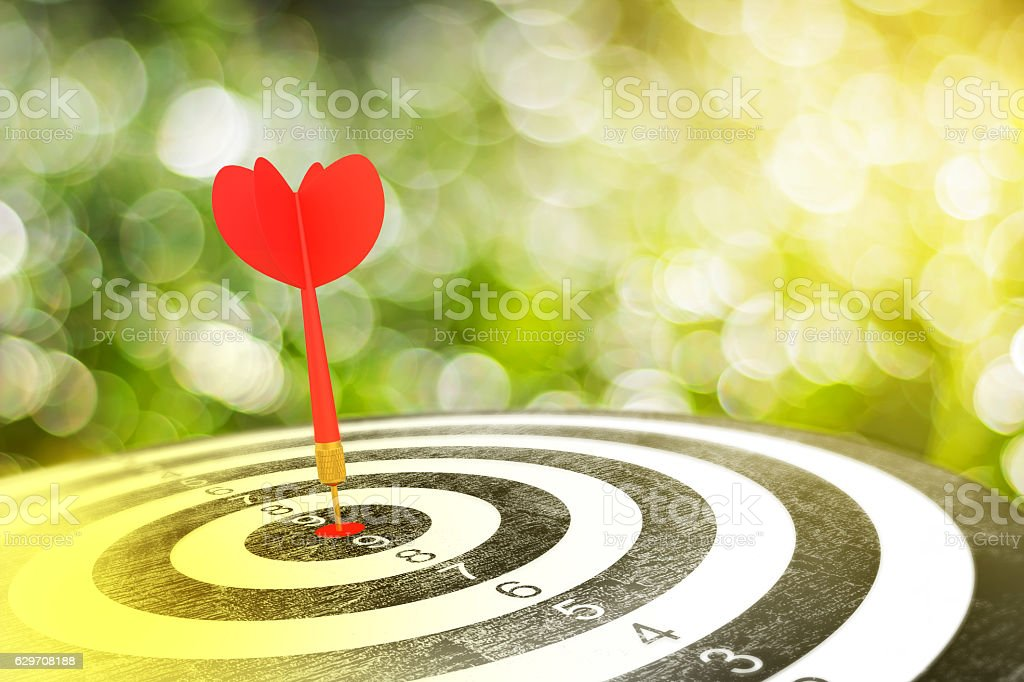Red arrow on target dart stock photo