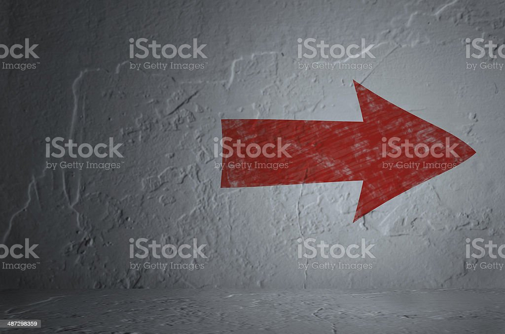 Red arrow on white wall stock photo