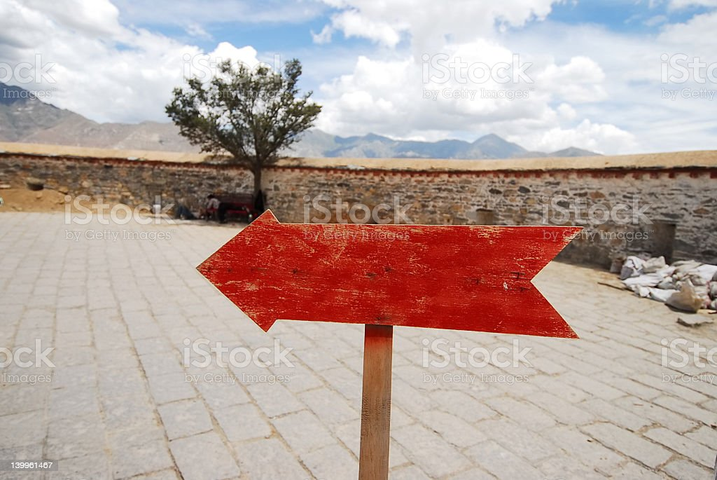 Red arrow pointing left royalty-free stock photo