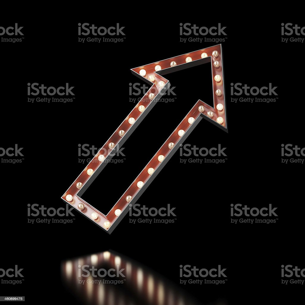 Red arrow sign lit up on a black background stock photo