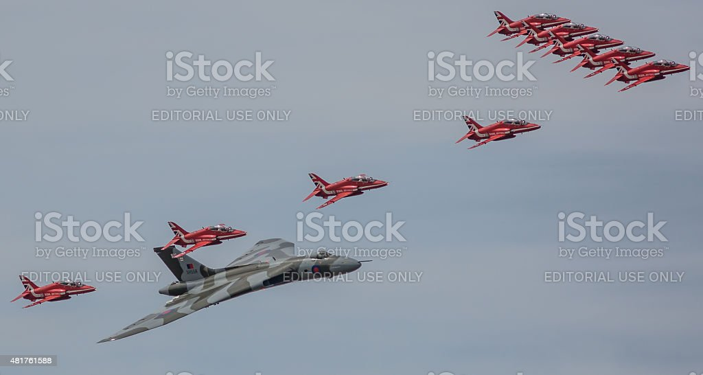 Red Arrows and Vulcan in formation stock photo