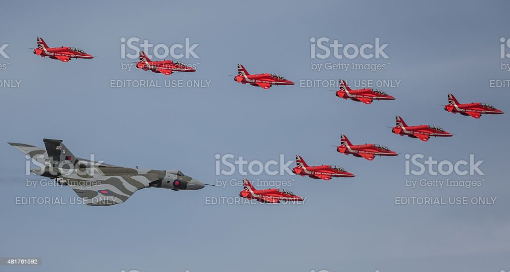 Red Arrows and Vulcan XH558 in formation stock photo