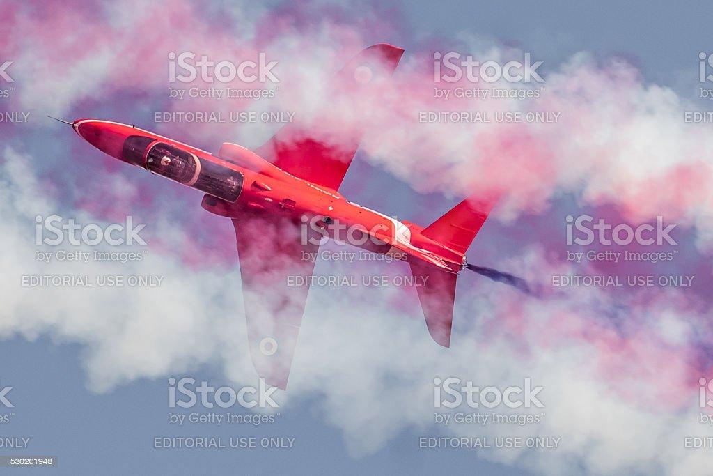 Red Arrows Hawk in Smoke Trail stock photo