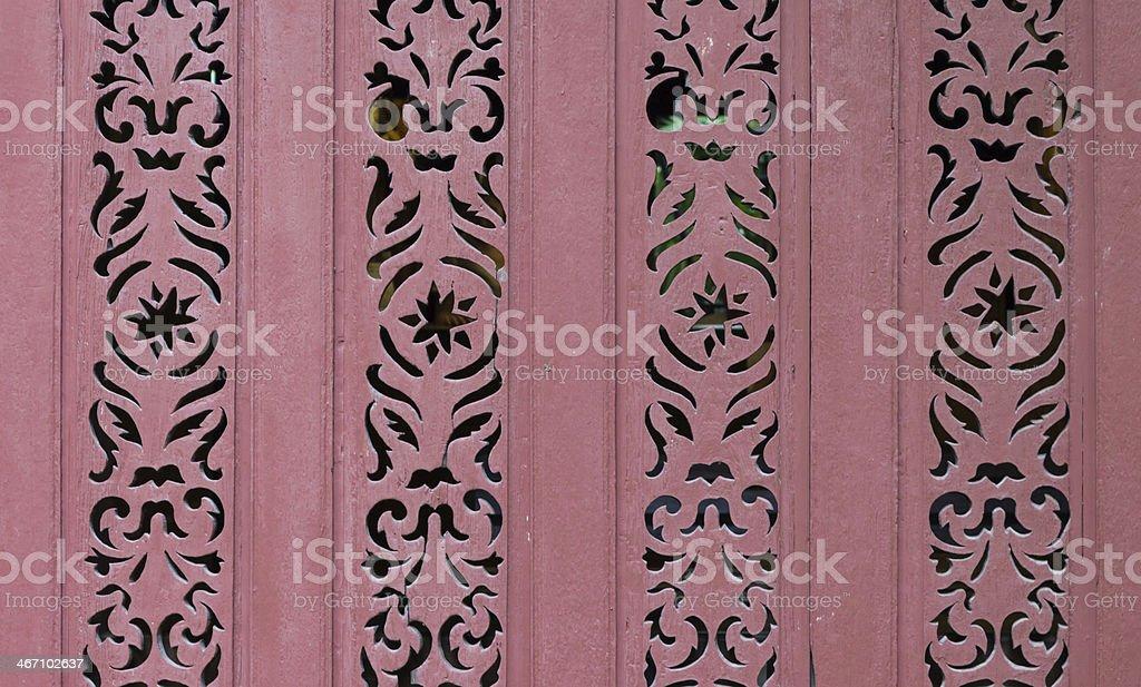 Красный art carve рисунком древесины Стоковые фото Стоковая фотография
