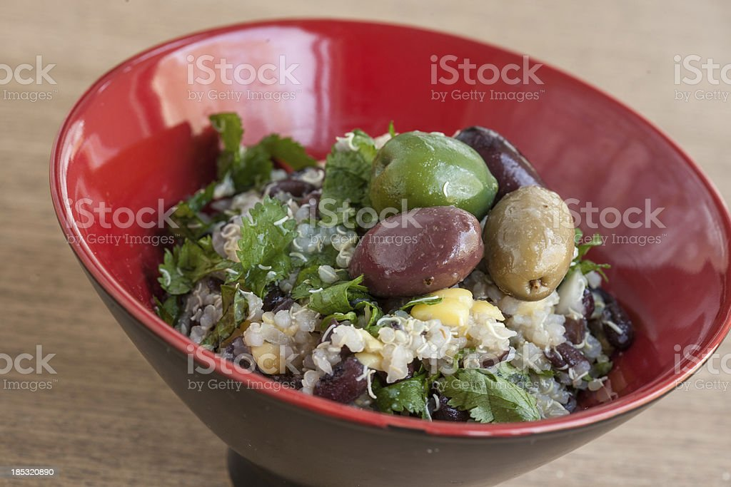 Red Asian Rice Bowl, Grains and Greens, Olives Quinoa stock photo