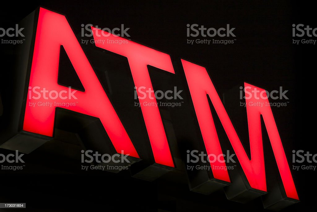 red ATM automated teller sign illuminated at night royalty-free stock photo