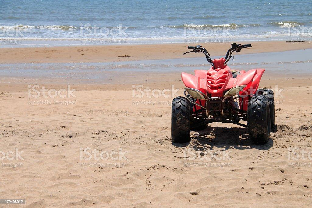 Red ATV on the beach stock photo