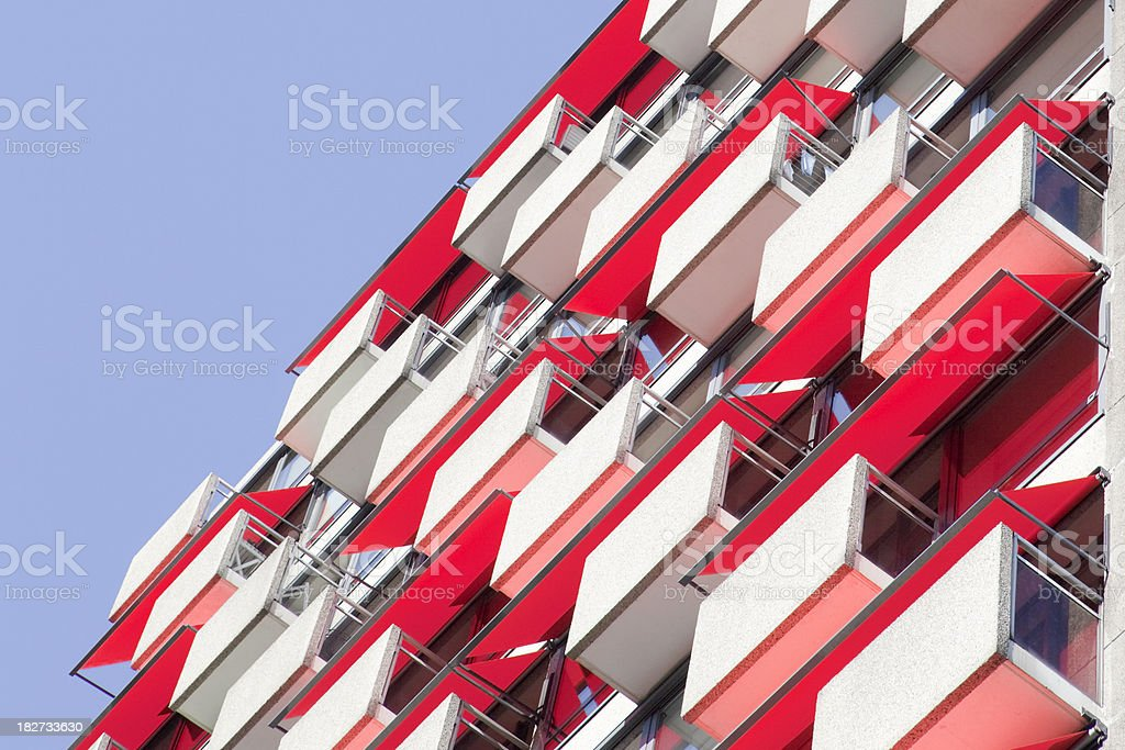 red awnings on an apartment building royalty-free stock photo