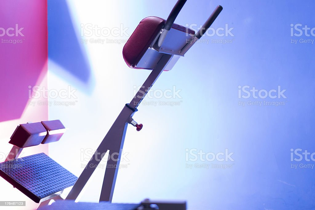 Red back extension machine on blue background stock photo