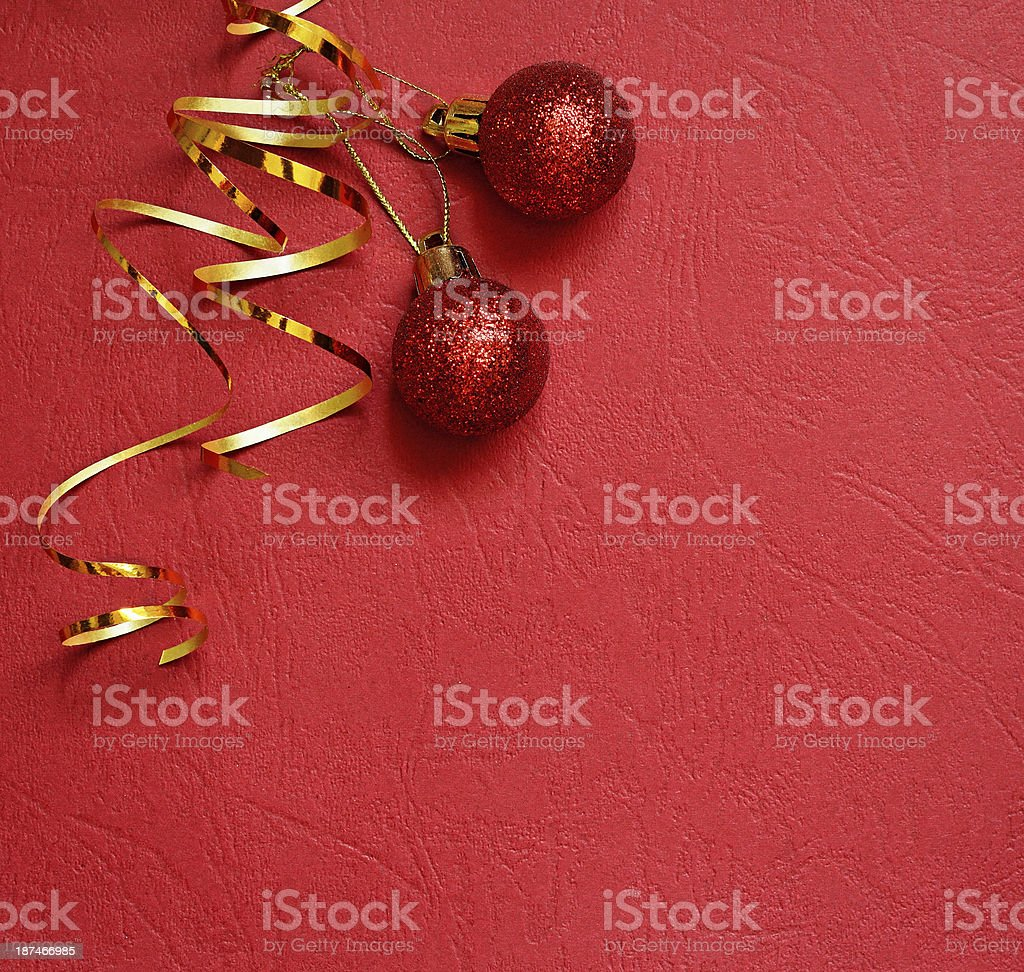 Red background with Christmas balls in a corner royalty-free stock photo