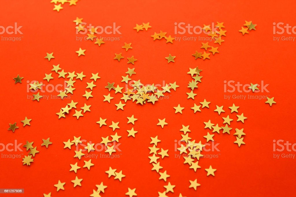 red background with white gold stars stock photo