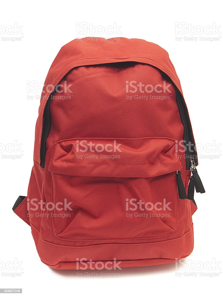 Red backpack upright on white background. stock photo