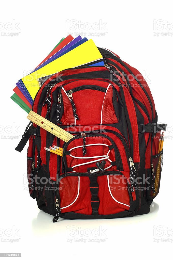 Red backpack with folders, a ruler, and pencils spilling out royalty-free stock photo