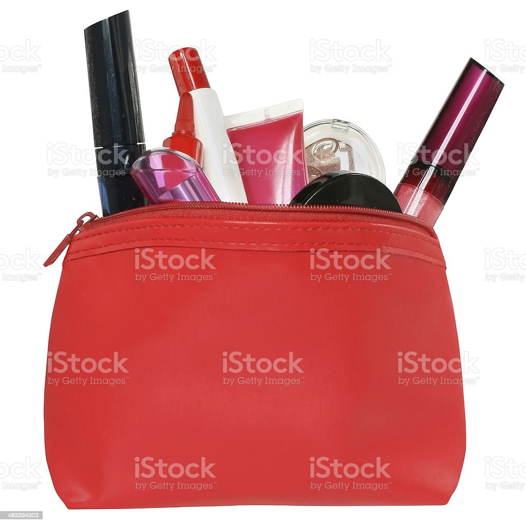 Red bag for cosmetics with a make-up accessories. stock photo