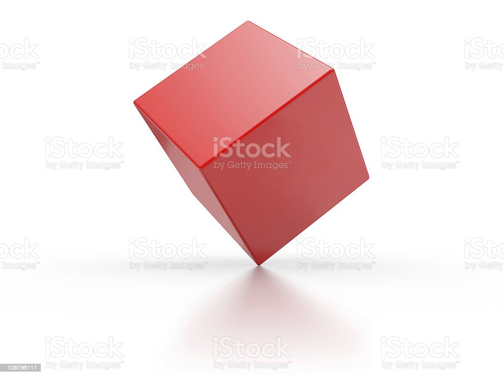 A red balancing cuboid isolated on a white background stock photo