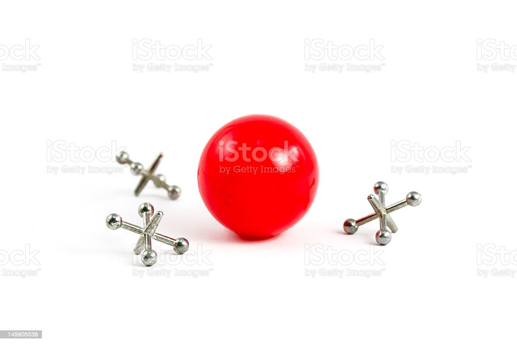 Red Ball and Jacks stock photo
