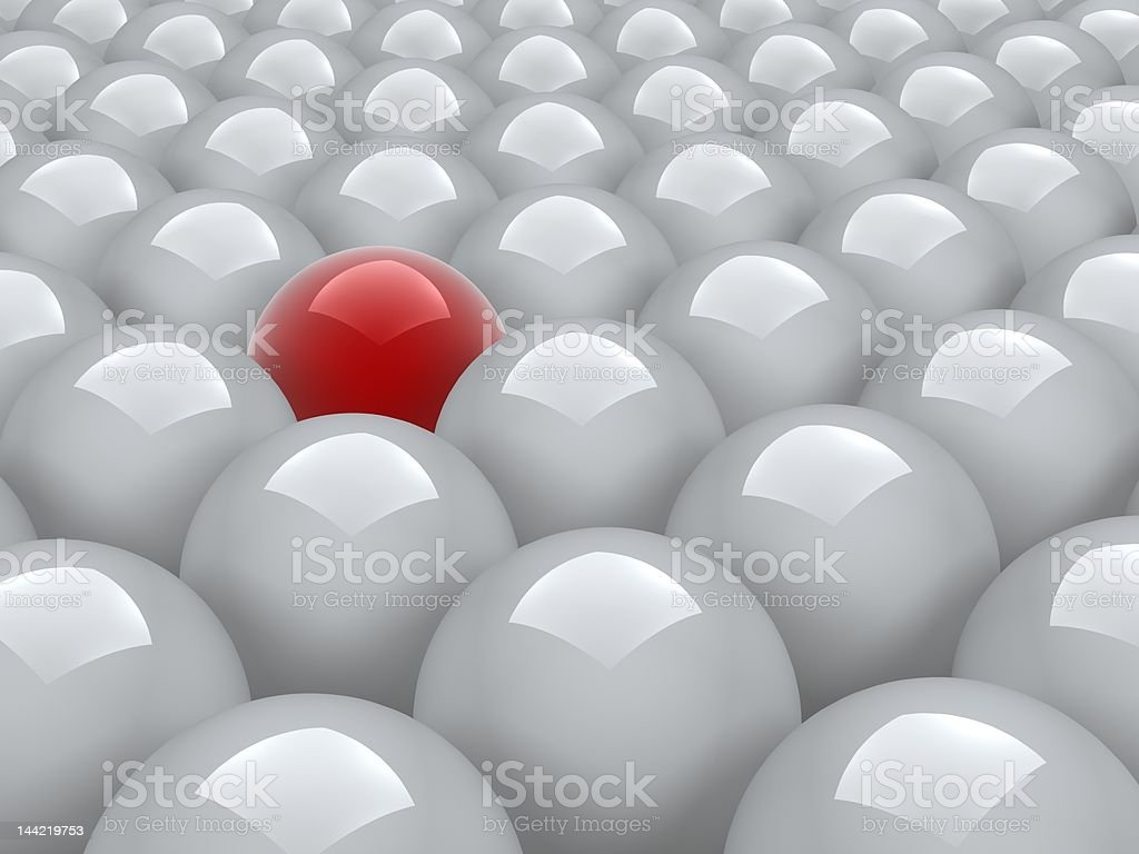 red ball in white ones royalty-free stock photo