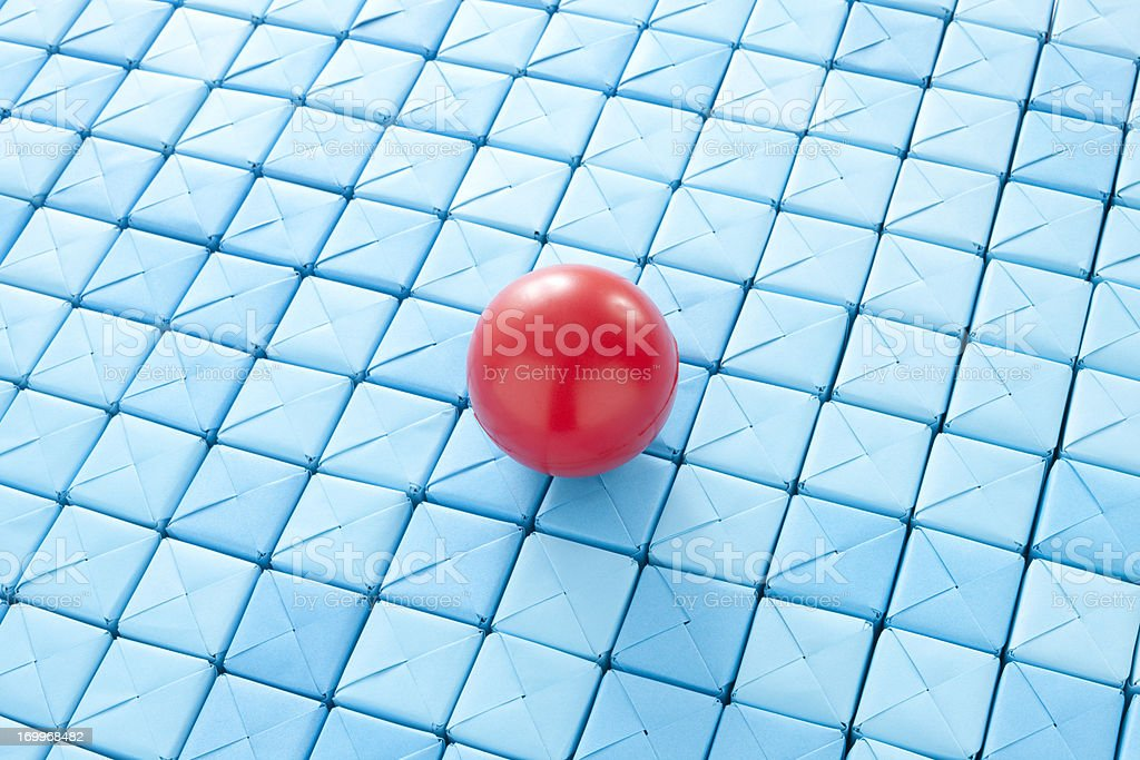 Red ball over blue cubes royalty-free stock photo