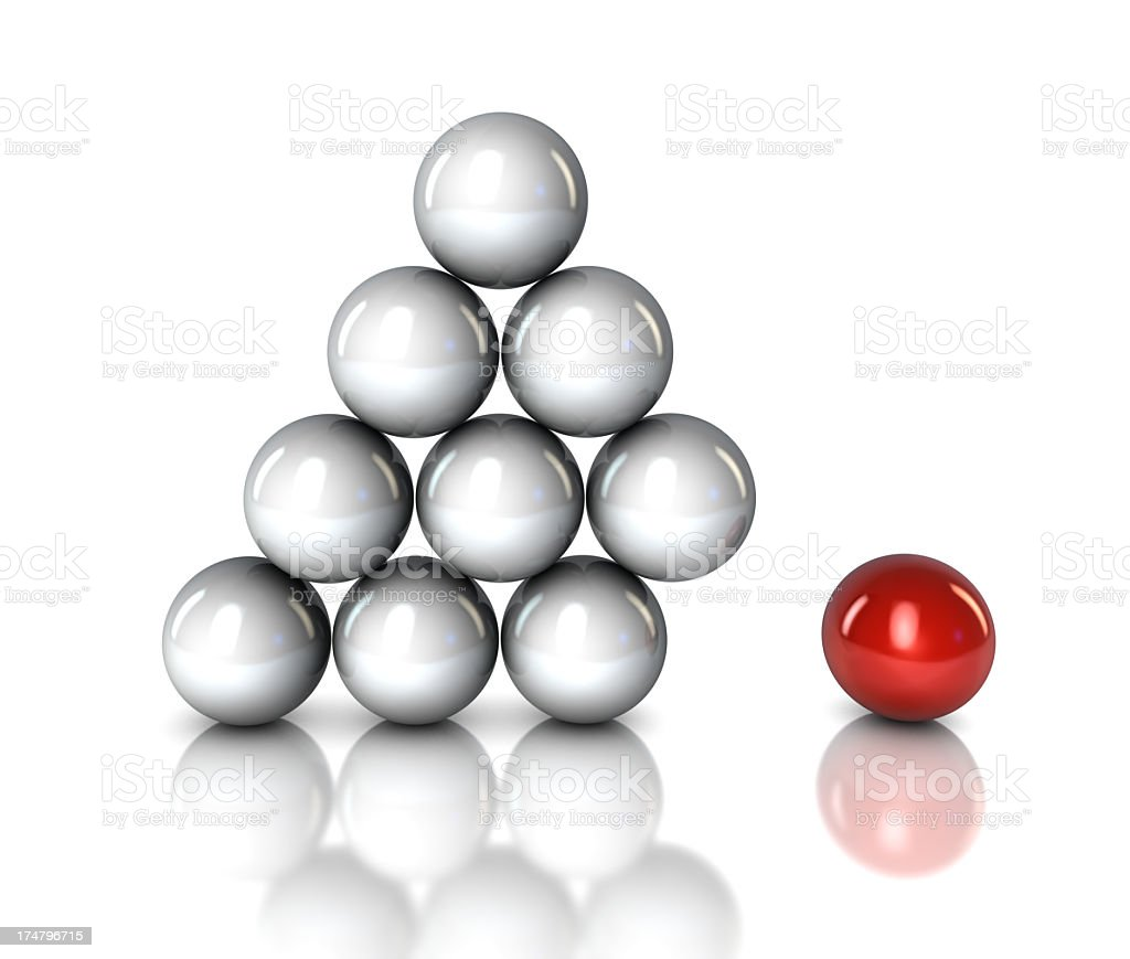 A red ball separated from a pyramid of clear balls  royalty-free stock photo