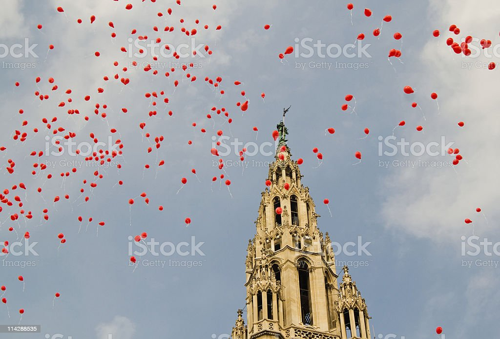 Red balloons flying at Vienna townhall royalty-free stock photo