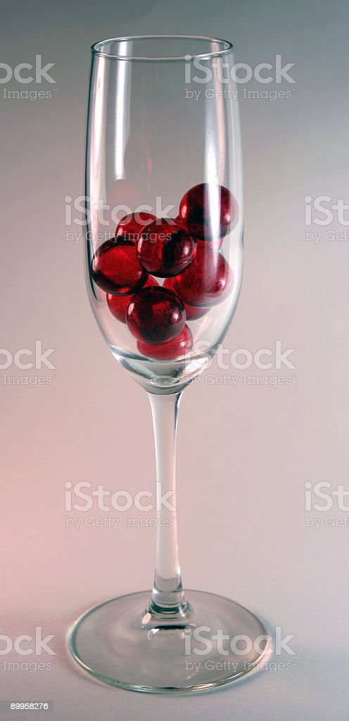Red Balls in Champagne Flute royalty-free stock photo