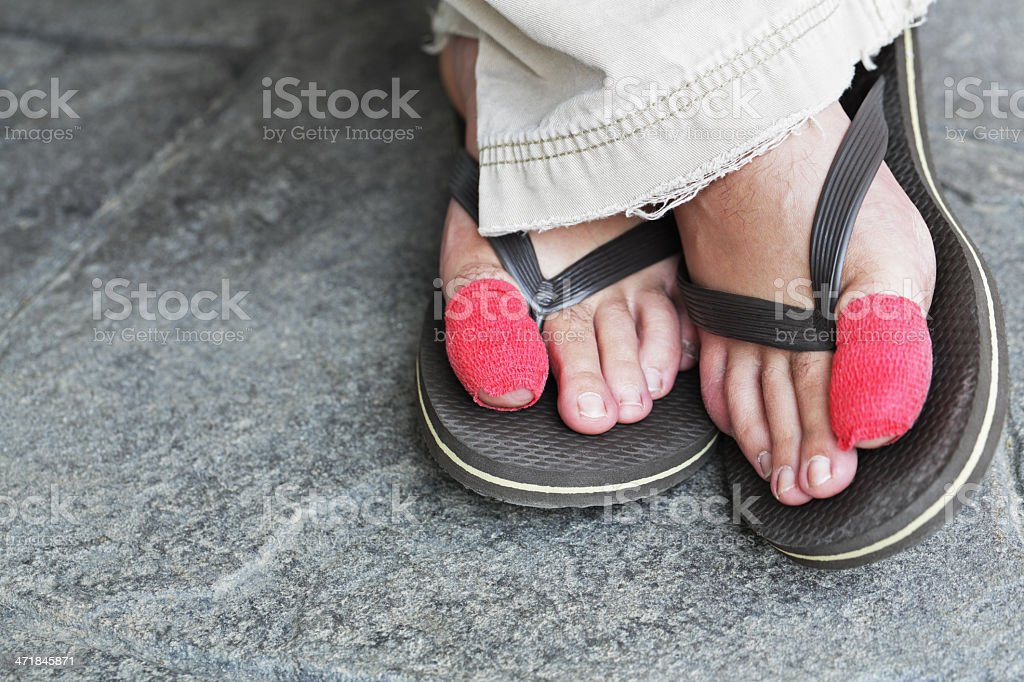 Red Bandaged Big Toes Relaxing stock photo