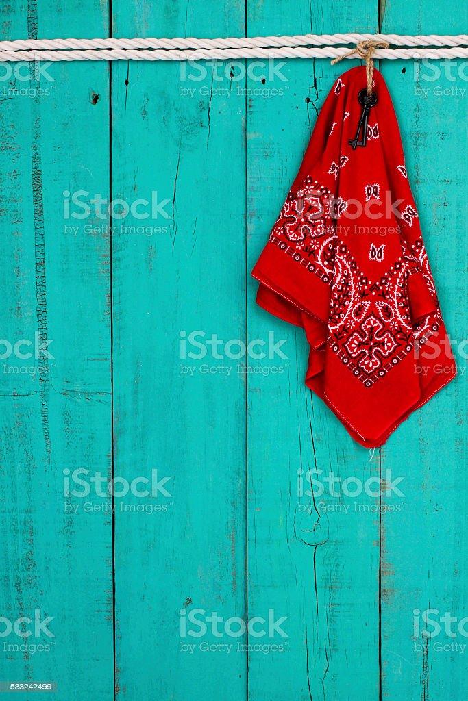 Red bandana and keys hanging on white rope stock photo