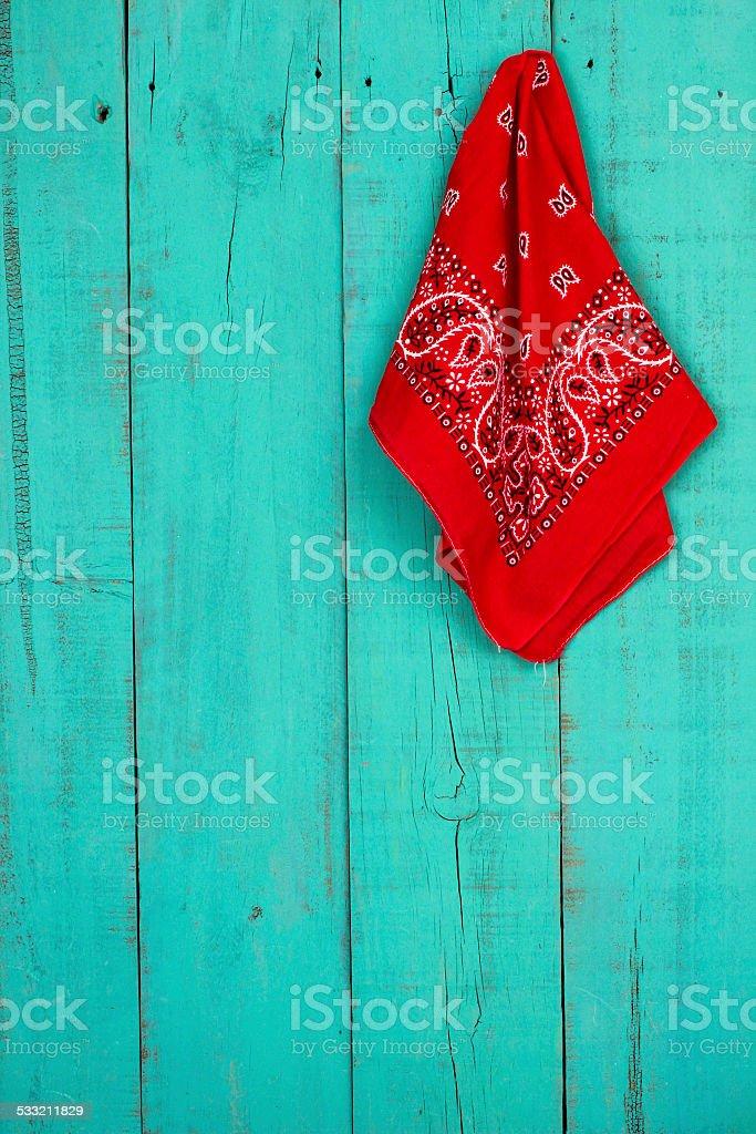 Red bandana hanging on wood background stock photo