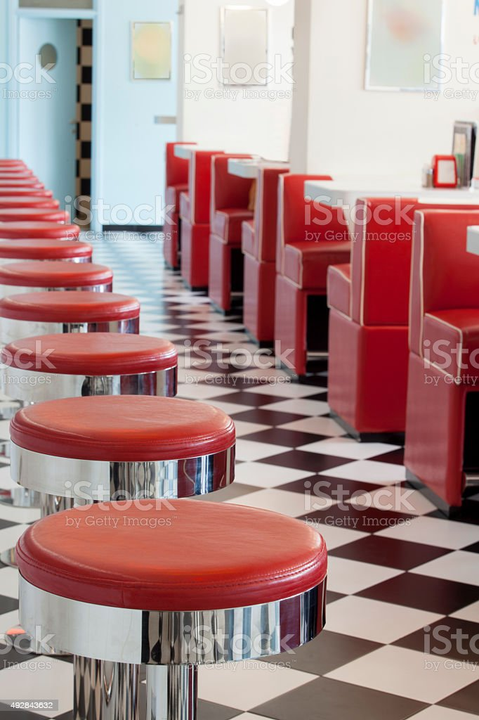 red bar stools stock photo