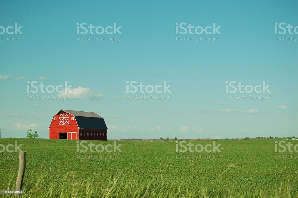 Red Barn and Vivid Sky in Summer stock photo
