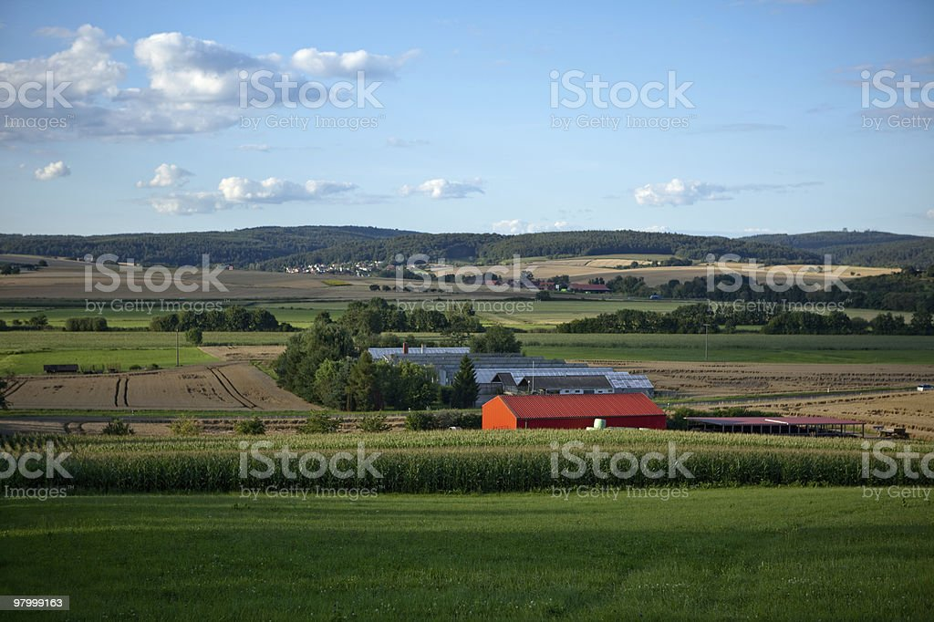 red barn corn field blue sky farmland country clouds green royalty-free stock photo
