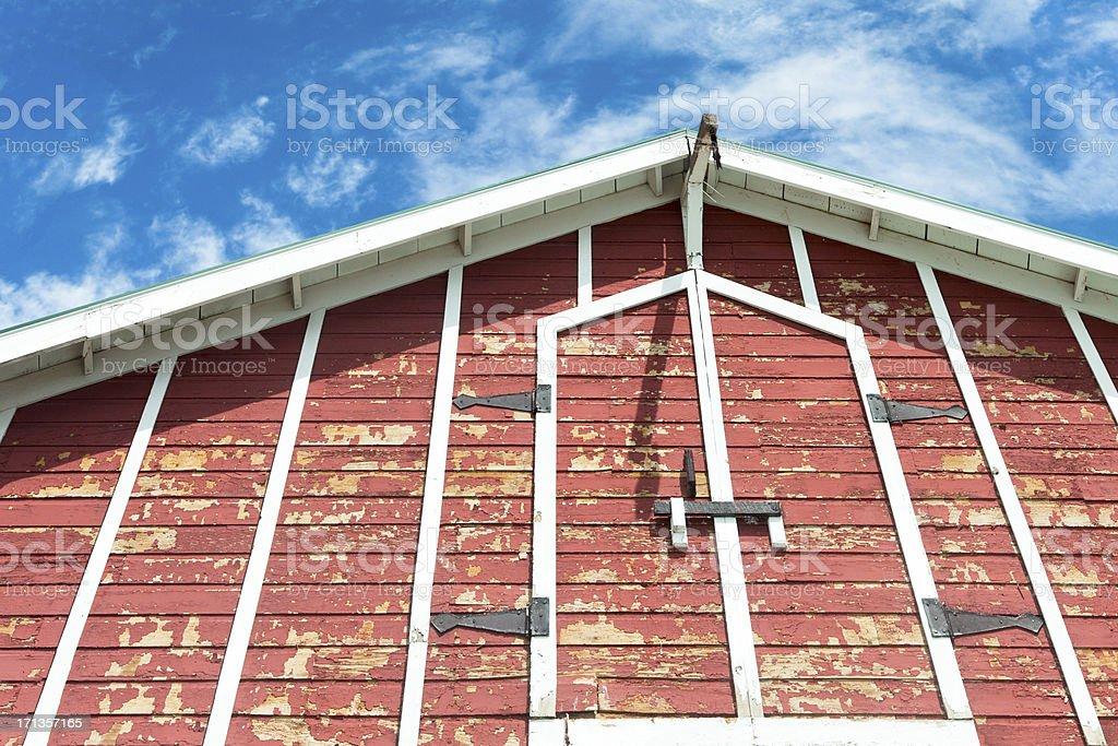 Red barn needing paint stock photo