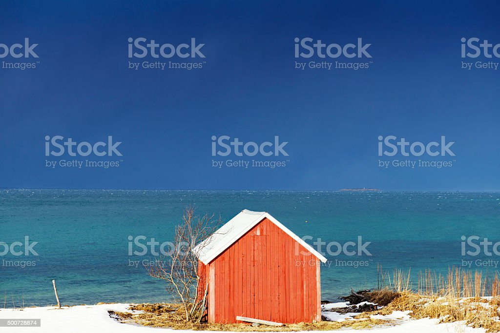 Red barn  on the fjord ,Lofoten and Vesteral Islands,Norway stock photo