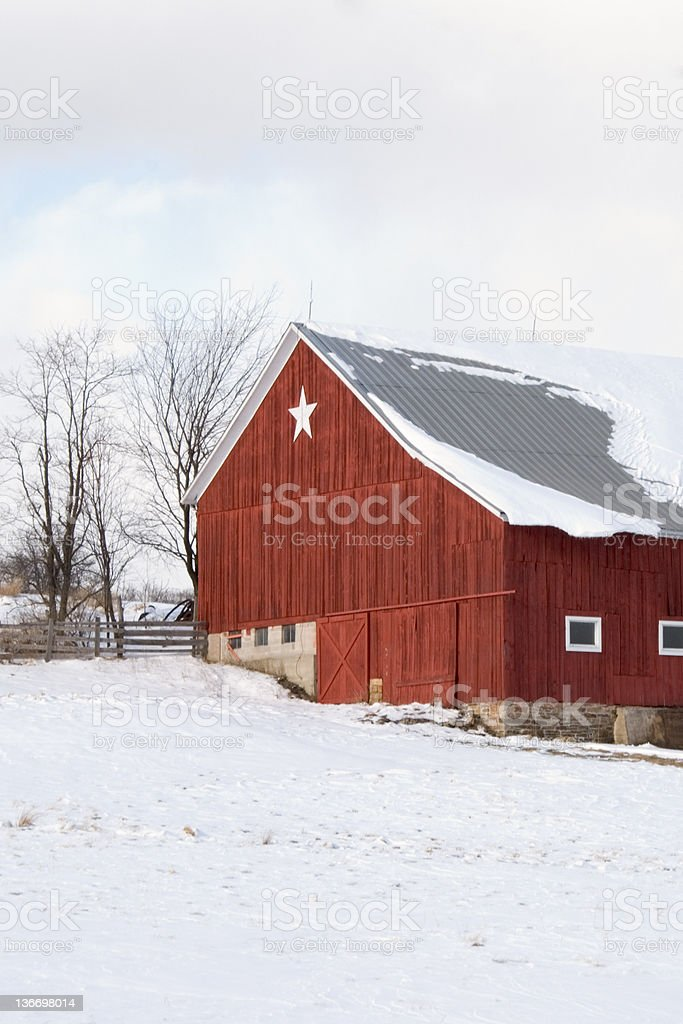 Red Barn with White Star in Winter Snow Landscape royalty-free stock photo