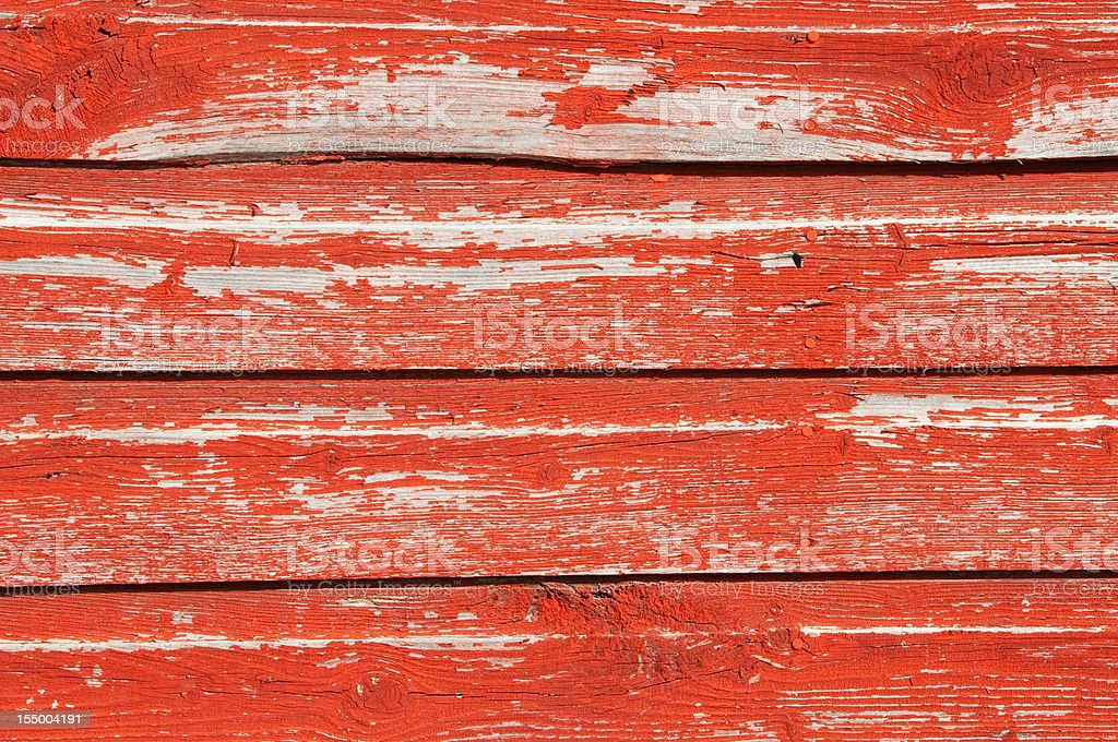 Red barn wood planks with peeling paint stock photo