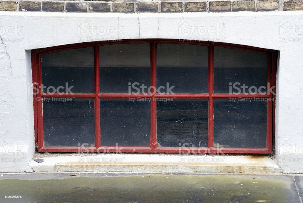Red basement window royalty-free stock photo