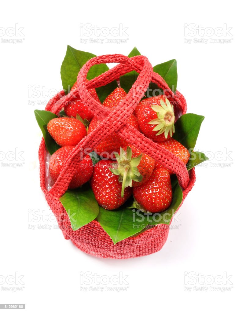 Red basket with strawberries stock photo