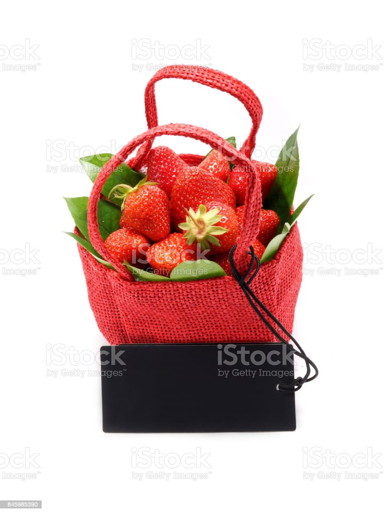 Red basket with strawberries with black price tag stock photo