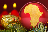 Red bauble with the golden shape of Africa.(series)