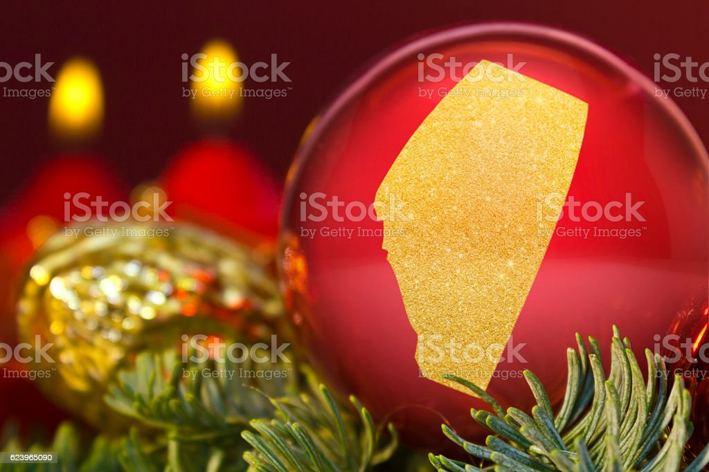 Red bauble with the golden shape of Alberta.(series) stock photo