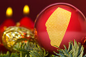 Red bauble with the golden shape of Alberta.(series)